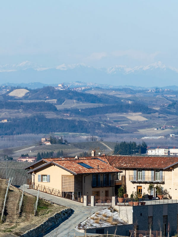Fortemasso winery in Barolo DOCG, with a view to the Alps in the background