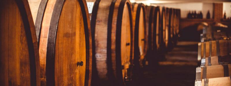 Oak barrels in the cellar at Francone winery