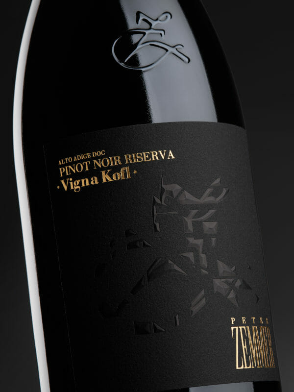 Bottle of red wine Pinot Noir Riserva Vigna Kofl 2017 on black background