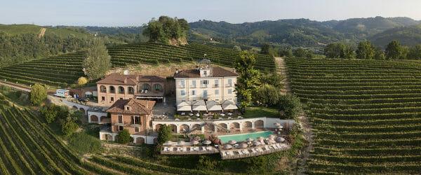 Drone view of Villa Tiboldi of Malvira on Trinita hill between vineyards in Roero, Langhe Piedmont