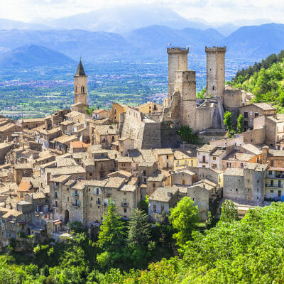 Towers in the village of Pacentro, and the Appenine mountains in the background in Abruzzo, Italy