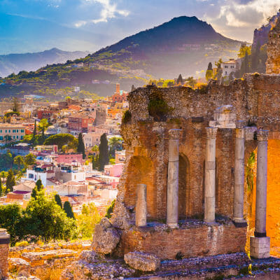 View of Ruins of Taormina Theater and mount Etna, Sicily, Italy