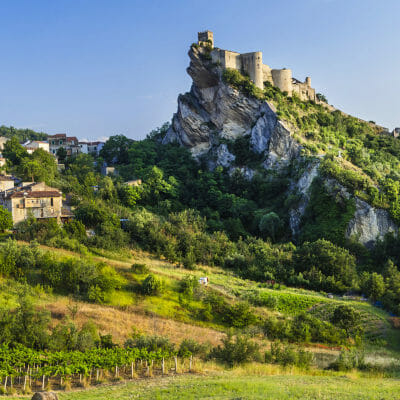 Vineyards in front of Roccascalegna castle on the rocky mountain in Abruzzo, Italy