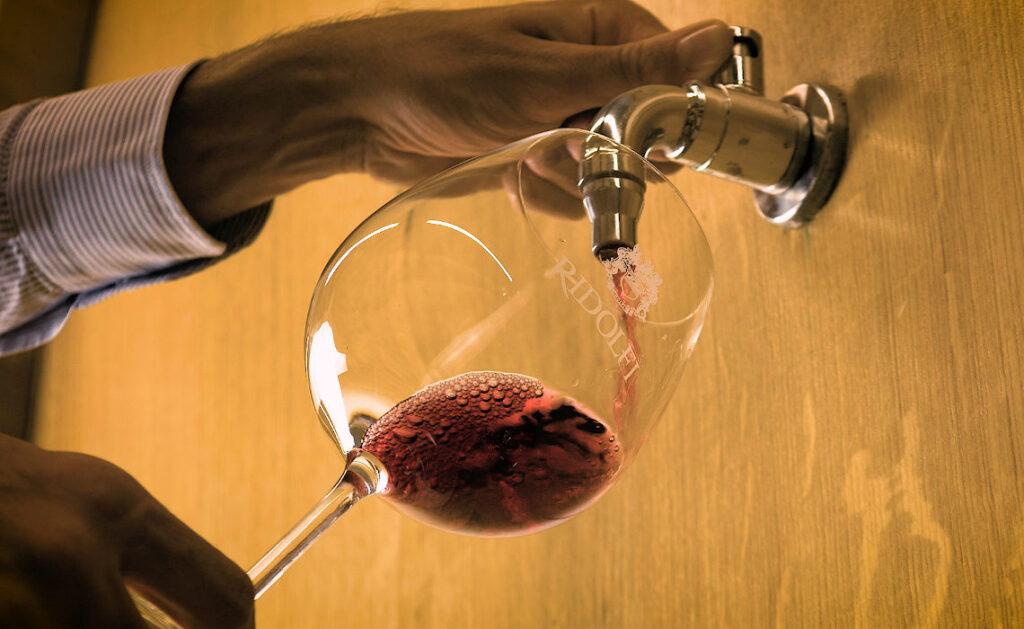 Pouring award-winning Ridolfi Brunello di Montalcino DOCG from the oak barrel