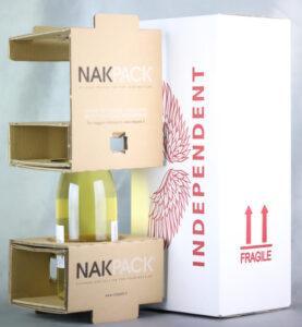 Bottle of white wine packaged in NakPack specialist wine packaging by Independent Wine