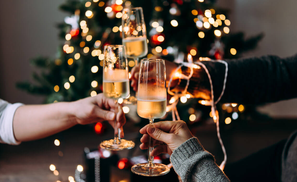 Friends toasting with sparkling wine at Christmas party