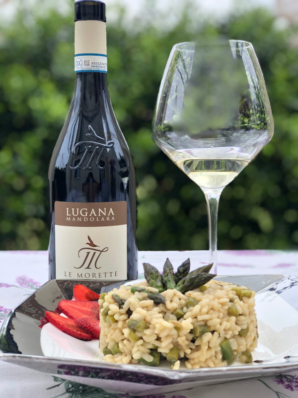 Asparagus Risotto with strawberries and a bottle of Le Morette Mandolara Logana DOC wine