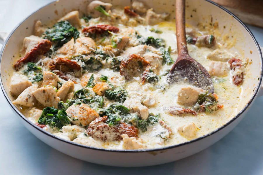 Zuppa Toscana - traditional Italian Tuscan soup with chicken and sun dried tomatoes, spinach and parmesan