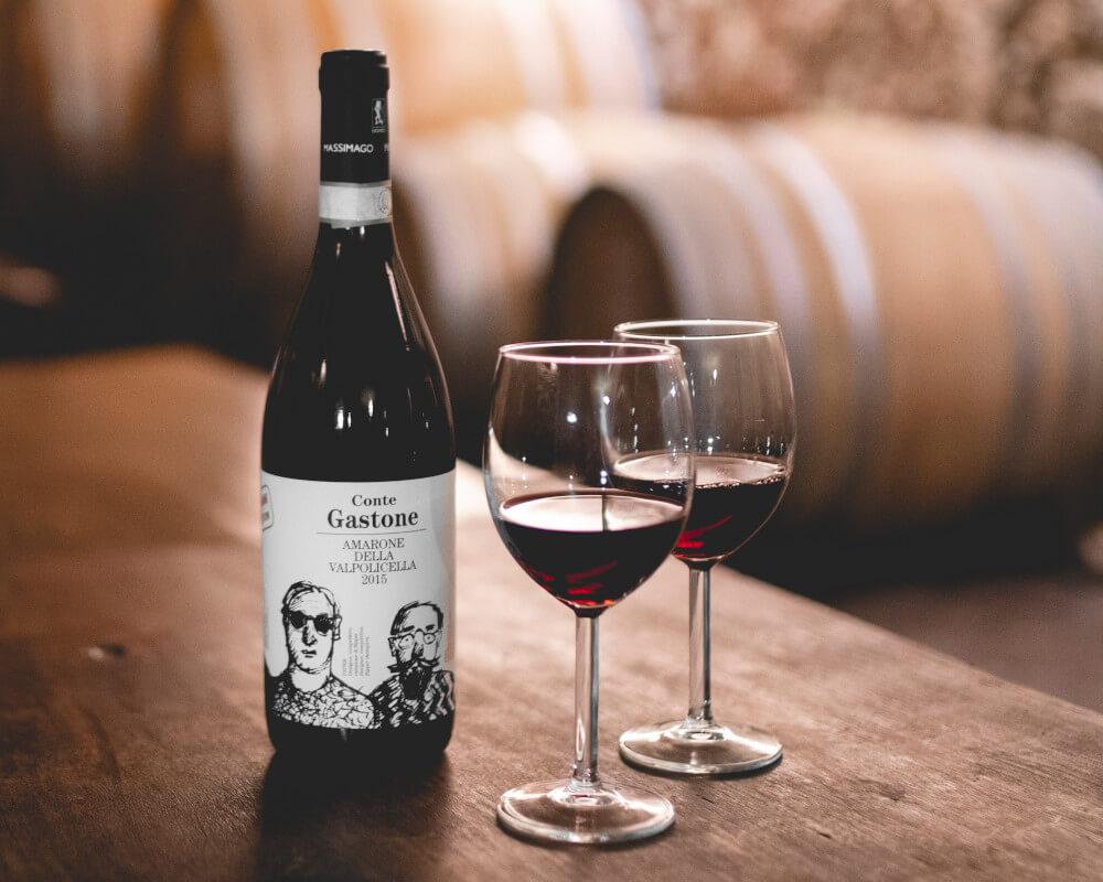 Massimago Conte Gastone Amarone Della Valpolicella with two glasses of wine