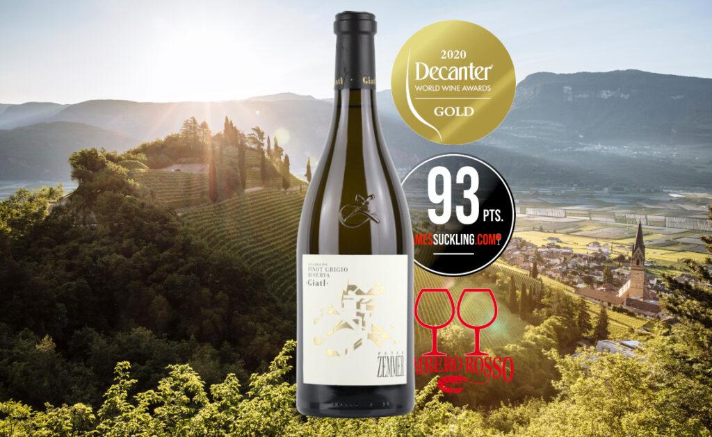 Bottle of Italian white wine Peter Zemmer Pinot Grigio Riserva Giatl - with background view of the Dolomite Alps