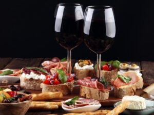 Selection of Italian Bruschetta and two glasses of red wine